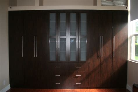 built in closet traditional bedroom miami by the