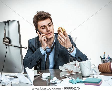 crating a while at work slacker talking on phone while image photo bigstock