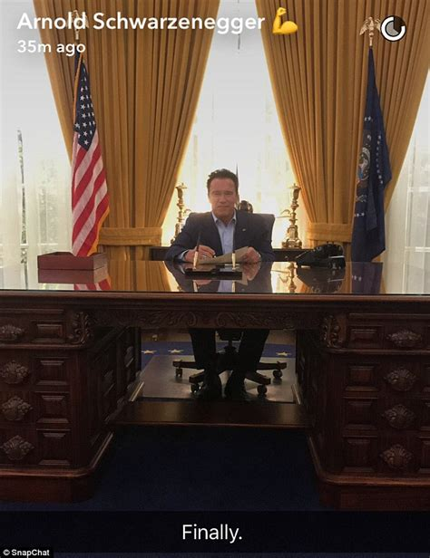 in oval office arnold schwarzenegger sits at replica of richard nixon s