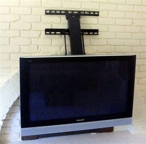 fireplace tv mount fireplace tv mount lowers 30 inches up