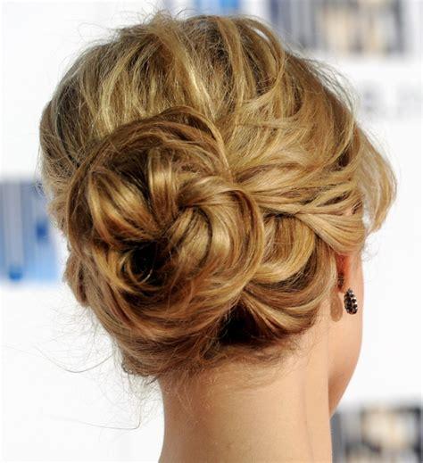 braidal low bun hairstyle with sassy braid designers
