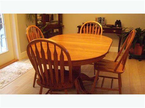 solid oak pedestal dining room table chairs outside
