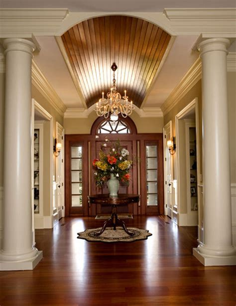 front foyer stained arched ceiling enhances foyer and relates to front