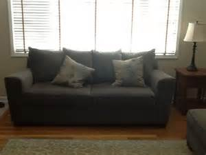 Roman Shades And Drapes - windows treatment options for bay window sofa in front of window