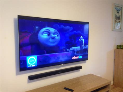 Sound Bar Mount On Top Of Tv by Tv Wall Mounting With Soundbar Perth Electrical