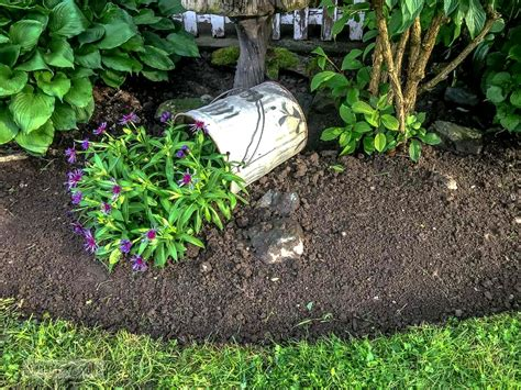 metal flower bed edging getting on with faux bucket of spring flowers and a