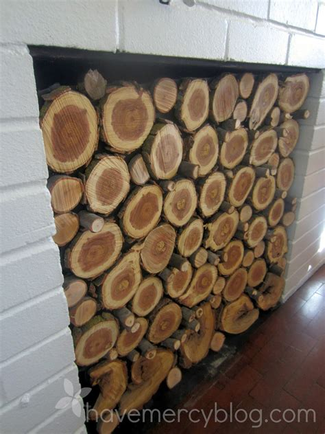 Stacked Logs In Fireplace by Mercy Living Room Redo Pinkified