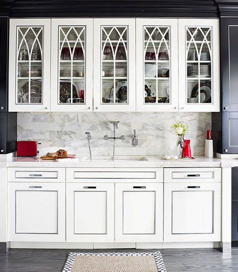 Glass Designs For Kitchen Cabinet Doors by White Kitchen Cabinets With Gothic Arch Glass Front Doors