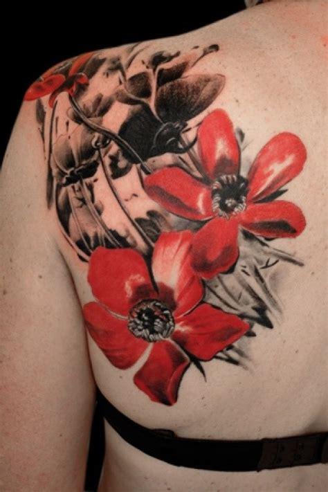 red and black tattoos and black flowers on shoulder blade