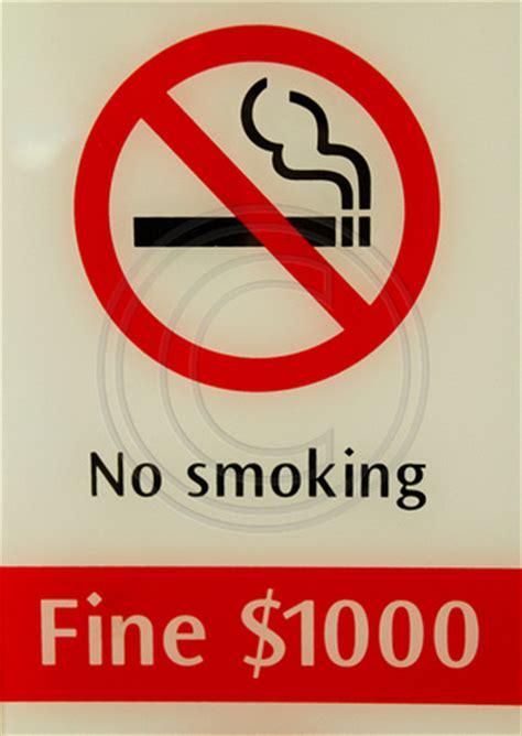 no smoking sign with fine bill yeaton travel photography singapore singapore no