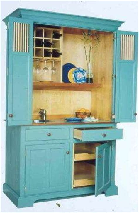 small kitchen armoire secret compartment cabinets compact culinary cabinetry conceals cooking clutter