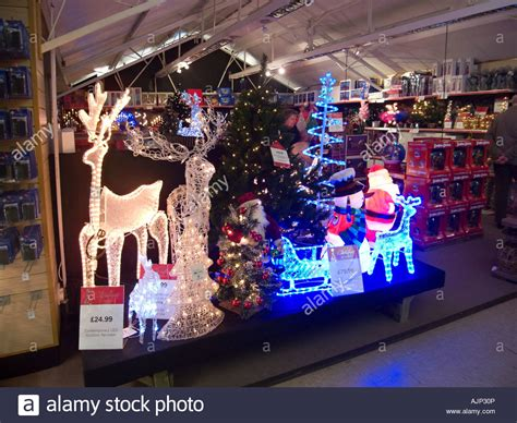christmas decorations on display in uk garden centre stock