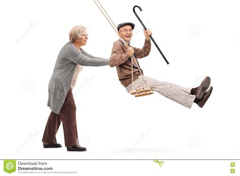 swinging man elderly woman pushing a man on swing stock photo image