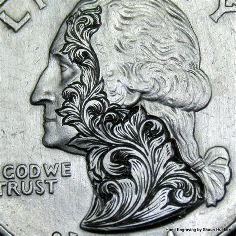 elaborate floral scrollwork engraved on coins by shaun