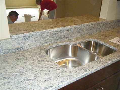 Corian Countertops Cost Vs Granite replacementcounters a comparison of corian vs granite upgrading countertops to sell