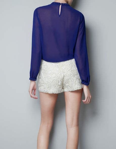 Zara Jumbo Blouse By Hana zara blouse with crystals around collar in blue blue lyst