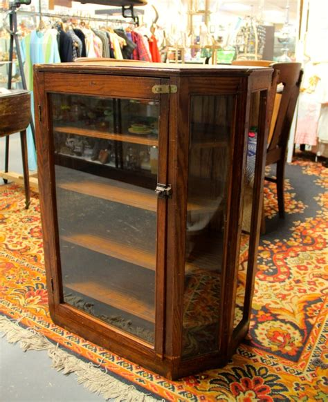 found in ithaca 187 antique glass front corner cabinet