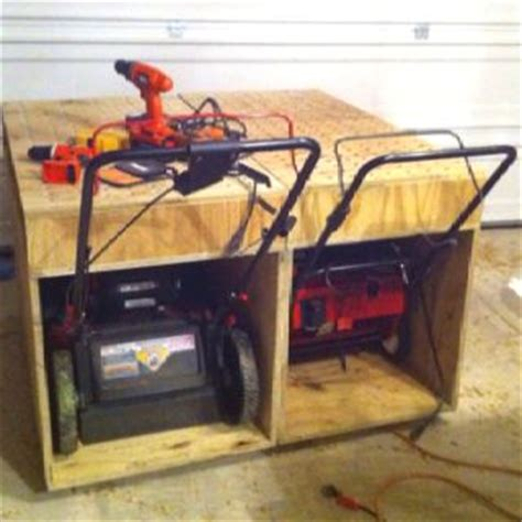 lawn mower work bench lawnmower storage on pinterest storage sheds sheds and