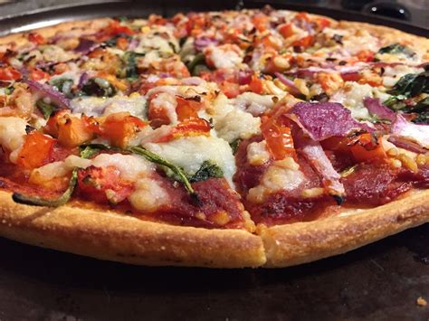 domino pizza vegan domino s australia launches vegan cheese is u s next peta