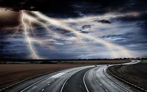 road track plain   field horizon sky clouds lightning