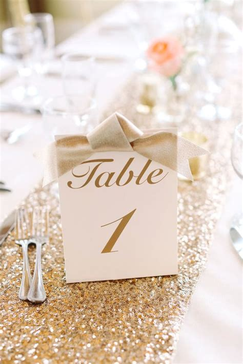 gold calligraphy table numbers picture of gold calligraphy table numbers with bows
