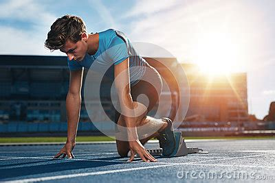 When Can I Start Running After Section by Runner Launching The Start Line Stock Photo Image