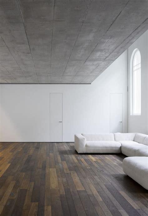 wood floor white wall concrete ceiling interior design
