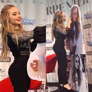 Sabrina carpenter poses with her cardboard cut out m magazine