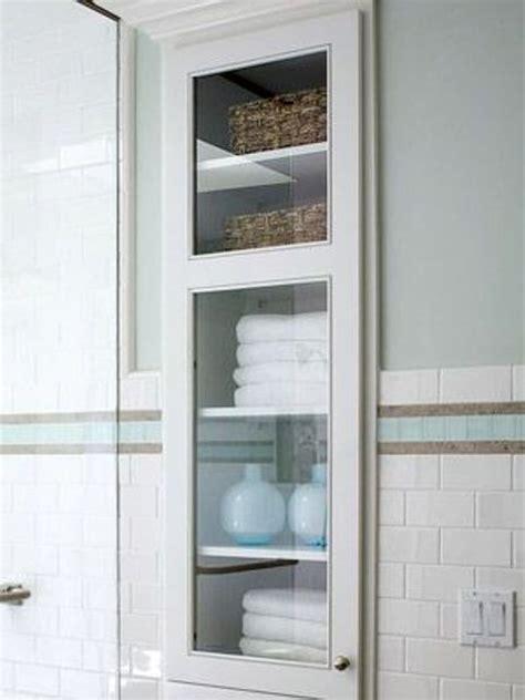bathroom cabinet between sinks