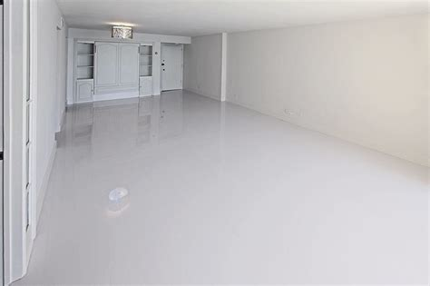 glass mirrors and glossy laminates up the posh white glossy laminate floors modern miami by glace