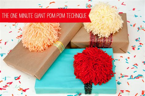 How To Make Large Paper Pom Poms - how to make a pom pom in 60 seconds flat favecrafts