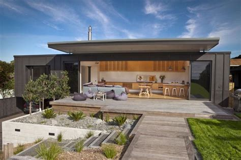modern home in new zealand screened by pohutukawa