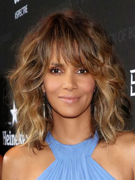 shoulder grazing hair halle berry medium curls with bangs shoulder length