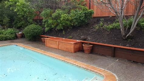 retaining wall with cap and redwood deck box yelp
