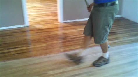 Wood Floor Sealer Finish by Applying Bona Mega Waterborne Wood Floor Finish In