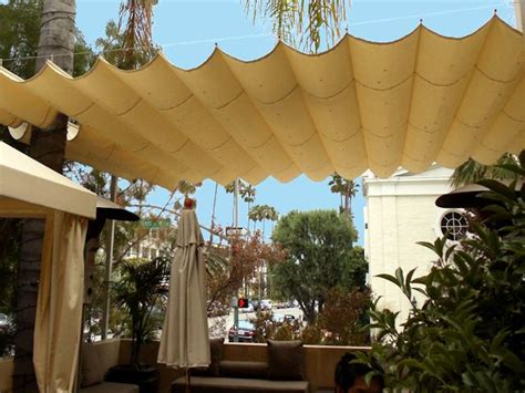 retractable fabric on cable patio cover houses