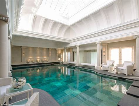 swimming pool room the house includes a steam room gymnasium and a huge