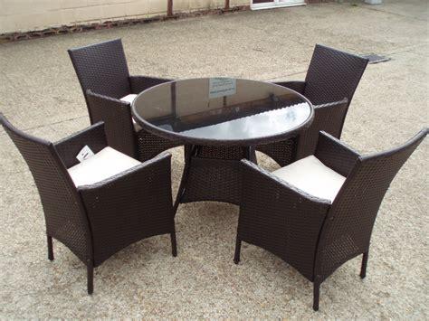 rattan table 4 arm chairs cushions wicker glass