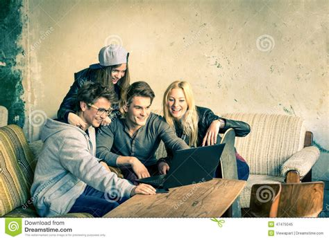 hipster male student showing thumb group stock photo group of young hipster best friends with computer laptop