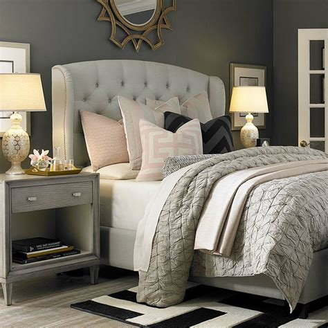 grey bed linens cozy bedroom with tufted upholstered bed neutral light