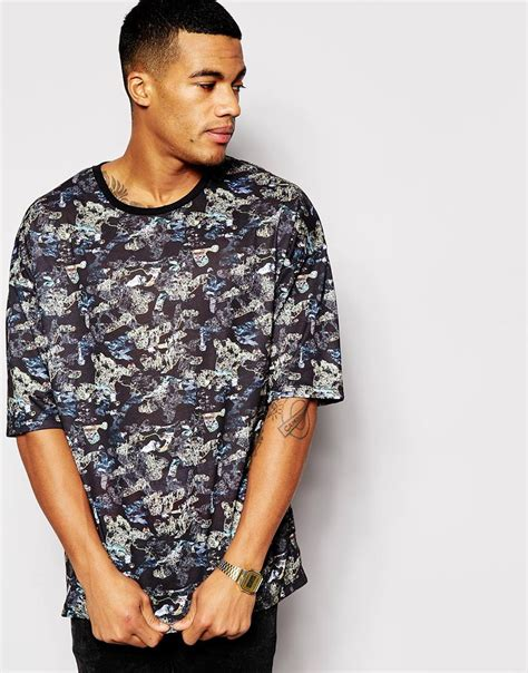 asos oversized t shirt with camo all print in green for lyst