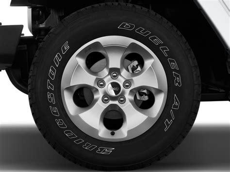 image  jeep wrangler unlimited wd  door sahara wheel cap size    type gif
