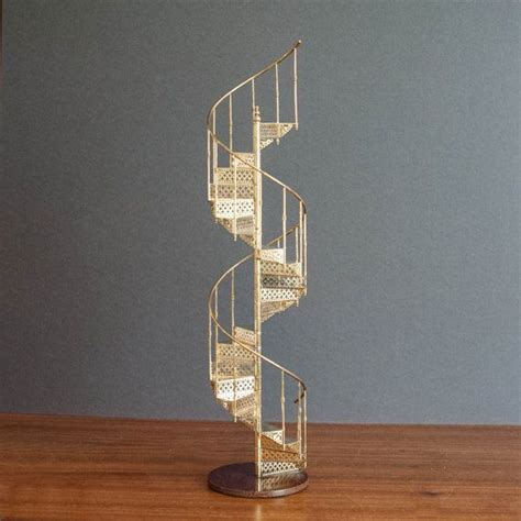 brass spiral staircase 1970s europe bookshelf decor