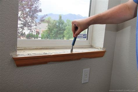 home improvement trimming a window replacing the sill
