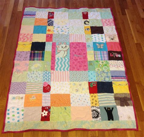 Patchwork Quilt Made From Baby Clothes - crafted custom embroidered patchwork baby clothing