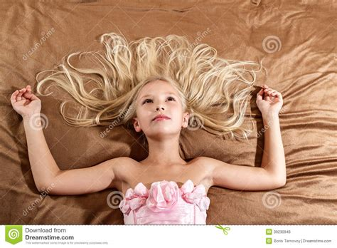 girl on bed beautiful little girl dreaming on bed stock photo image