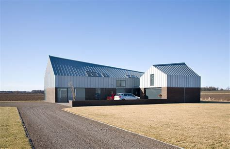 Design Of Houses exterior with curved zinc roof her indoors