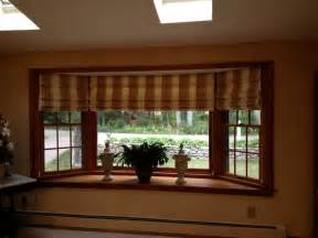 hobbled roman shade for bay window another bow window treatment home the generous master