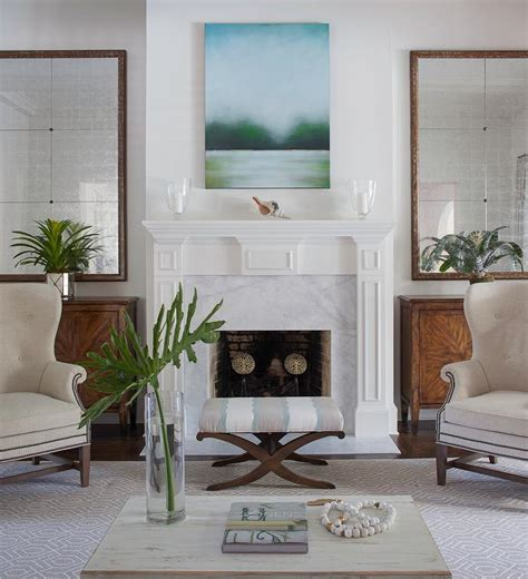 decor pad living room living room fireplace flanked by mirrors and cabinets traditional living room