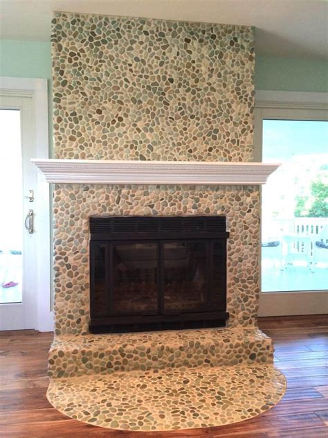 Pebble Tile Fireplace by 19 Stylish Fireplace Tile Ideas For Your Fireplace Surround
